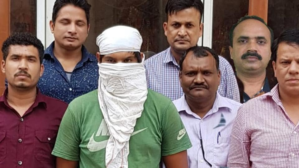 The 19-year-old accused, Sahil, in police custody on Tuesday. Sahil and his juvenile friend were held after the bandage on the arm of the juvenile gave away their identities.