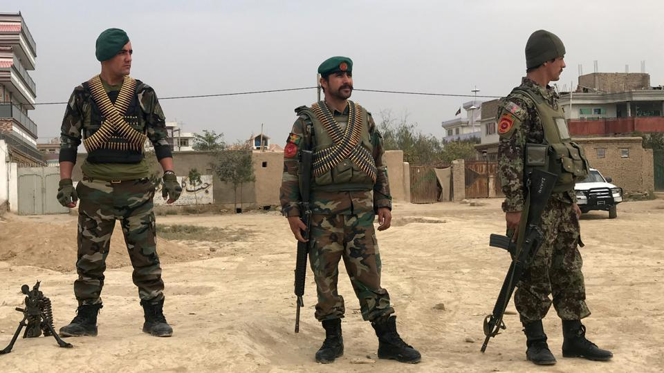 Afghan national army soldiers keep a watch near the site of a blast in Kabul, on Wednesday, October 31, 2018.