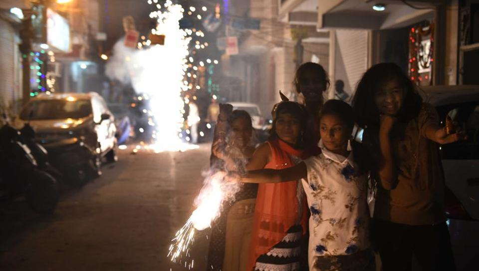 Children enjoy as they burst crackers on the occasion of Diwale in Mayur Vihar on October 19, 2017.