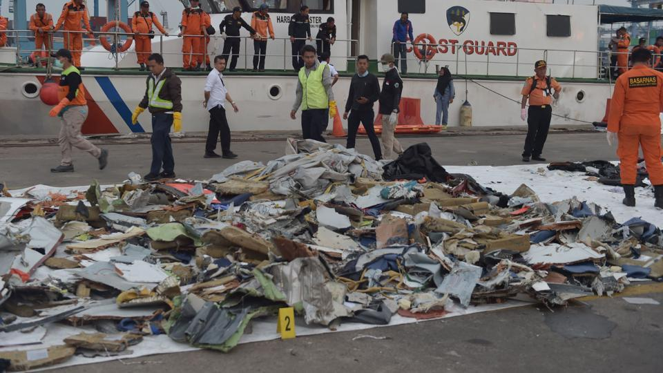 This picture taken at the Tanjung Priok Jakarta port shows Indonesian people examining debris of the ill-fated Lion Air flight.