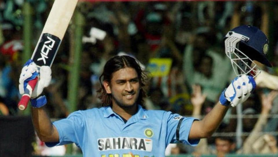 Mahendra Singh Dhoni celebrates after reaching his century against Sri Lanka in Jaipur on October 31,2005.
