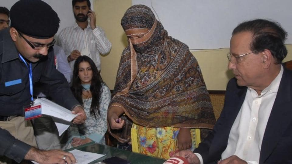 File photo of a  police official taking the thumb print of Asia Bibi, a Pakistani Christian woman who was sentenced to death for blasphemy. Pakistan's top court overturned her death sentence on October 31, 2018.