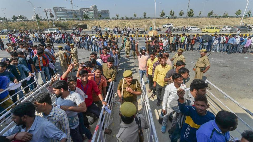Cricket fans queue up to buy tickets for the forthcoming T20 match between India and West Indies at Lucknow's Ekana Stadium. Lucknow will be hosting its first international cricket match in over two decades when India and West Indies will play this T20I cricket match at the city's Ekana Stadium on November 6. (Nand Kumar / PTI)