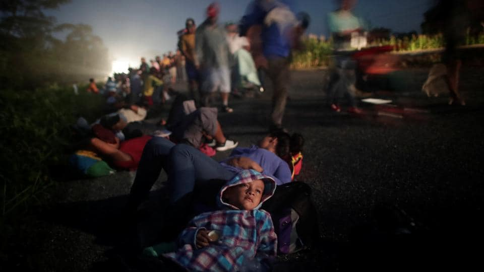 Just past 4am, under a star-streaked sky, the Central American migrants shouldered their bags and picked over broken sidewalks, - first as a trickle, then as a flood - to the edge of a Mexican town. They walked straight, without hesitation. Few spoke much. Their compass point was north, towards the United States. (Ueslei Marcelino / REUTERS)