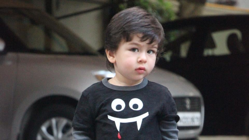 Taimur Ali Khan poses for camera men at Arpita Khan's Halloween party.
