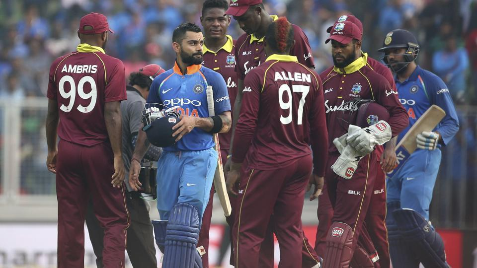 India's captain Virat Kohli, second left, and teammate Rohit Sharma, right, leave the field with by West Indies' players after their win in the fifth and last one-day international cricket match in Thiruvananthapuram