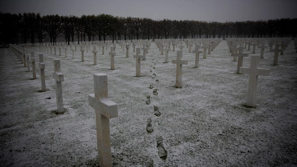 Footsteps are seen as the snow falls at the Meuse-Argonne American WWI cemetery in Romagne-Sous-Montfaucon, France. (Virginia Mayo / AP)