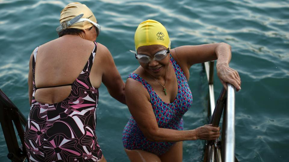 "Women prepare to swim in the sea at the Sai Wan Swimming Shed. ""I feel there is more plastic in the sea,"" said Dennis Yeung, 58. ""I have noticed a difference since I've been swimming here from when I was small... There is quite a big difference. In the future, it will be more of a problem too."" (REUTERS / Hannah McKay)"