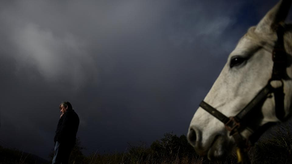 A man makes a phone call at the annual Maam Cross fair in the Connemara region of Maam Cross in Galway, Ireland. (Clodagh Kilcoyne / REUTERS)