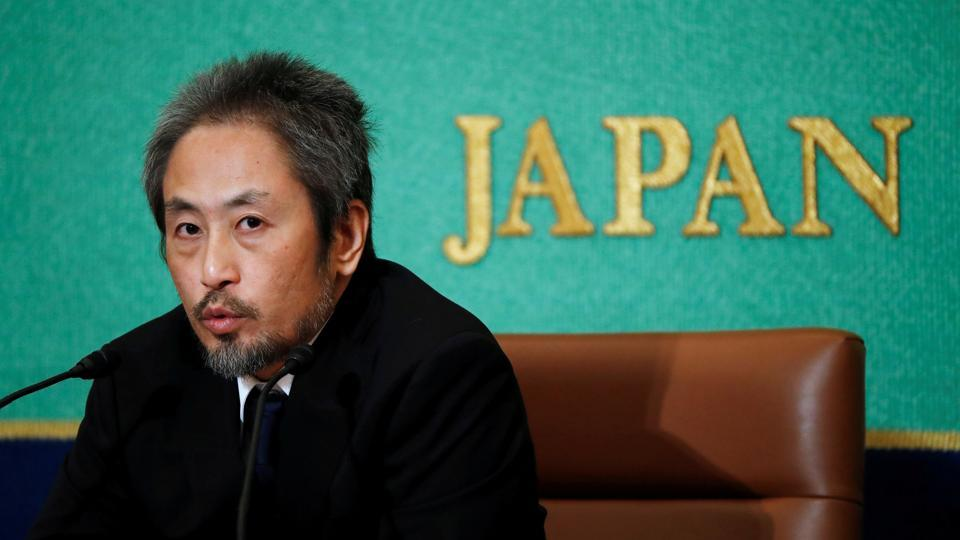 Jumpei Yasuda, the Japanese journalist held in Syria for more than three years, addresses a news conference for the first time since his release last month, at the Japan National Press Club in Tokyo, Japan. (Issei Kato / REUTERS)