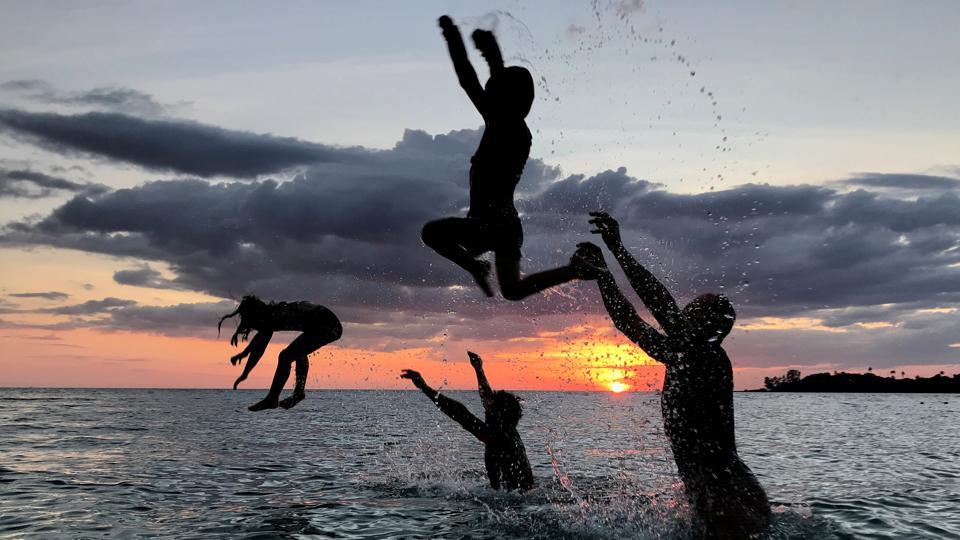 People have fun on a beach during sunset at Ko Kut island in Trat Province, Thailand. (Jorge Silva / REUTERS)