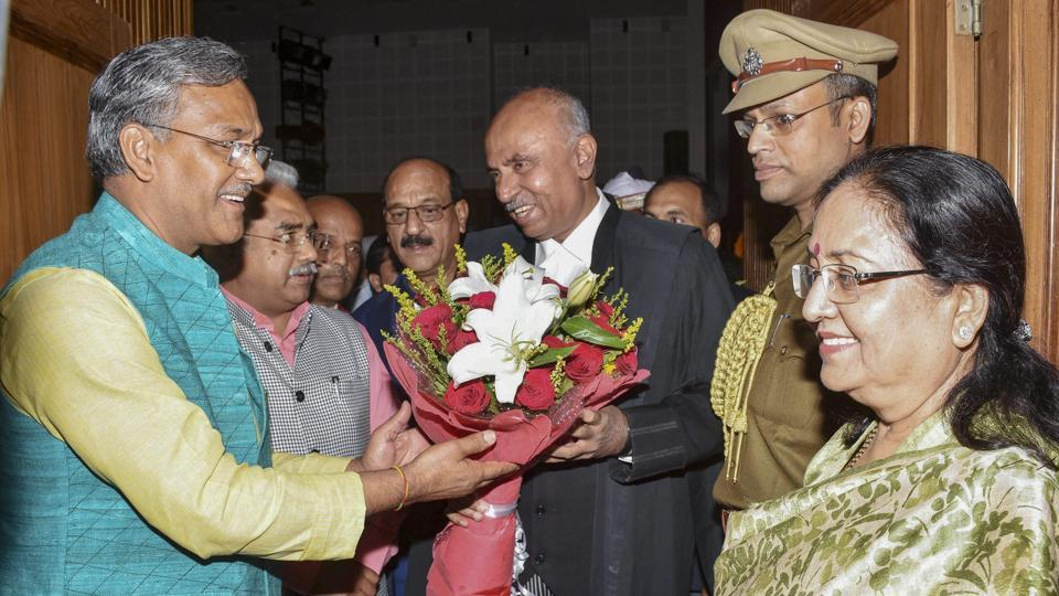 Uttarakhand chief minister Trivendra Singh Rawat greets the newly appointed Justice Ramesh Ranganathan, as the Chief Justice of Uttrakhand high court at Raj Bhavan, in Dehradun on November 2.