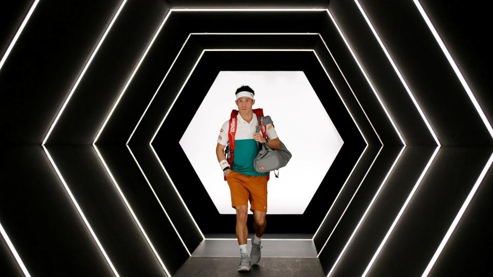 Japan's Kei Nishikori walks out for his second round match against Adrian Mannarino of France during the Paris Masters at AccorHotels Arena in Paris, France. (Gonzalo Fuentes / REUTERS)