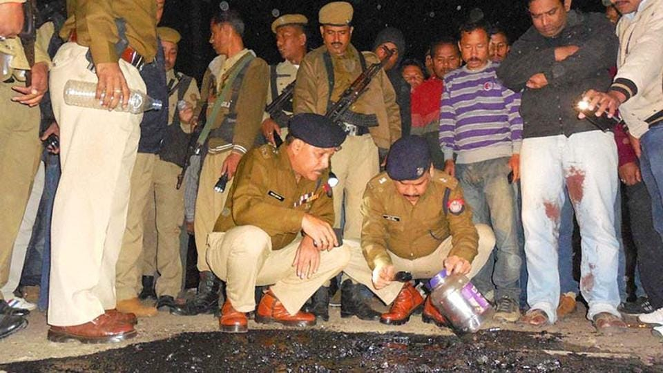 Police officials at a blast site in Dibrugarh in Assam. The state is affected by numerous militant groups. (PTI photo)