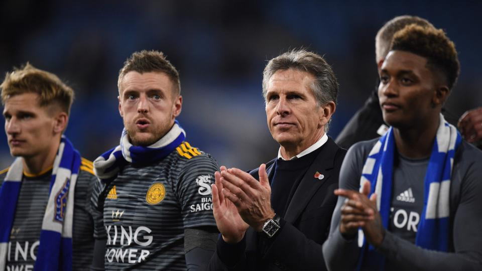 Leicester City's English midfielder Marc Albrighton (L), Leicester City's English striker Jamie Vardy (2L), Leicester City's French manager Claude Puel (2R) and Leicester City's English midfielder Demarai Gray applauds the fans following the English Premier League football