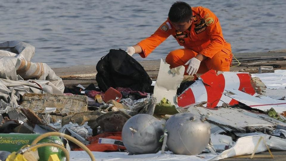 Indonesian rescue workers inspect debris believed to be from the Lion Air passenger jet that crashed off Java Island.