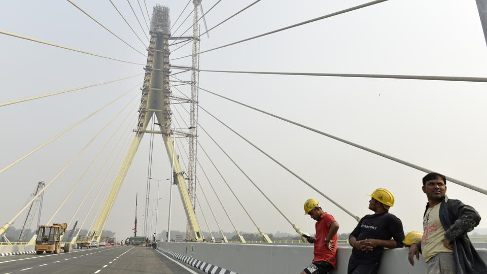 """We want to appeal to people of Delhi to come to the inauguration ceremony. There will get the opportunity to see how the bridge without a pillar works. It will be followed by a laser show,"" Sisodia said after inspecting the infrastructure project on Friday. (Sanchit Khanna / HT Photo)"