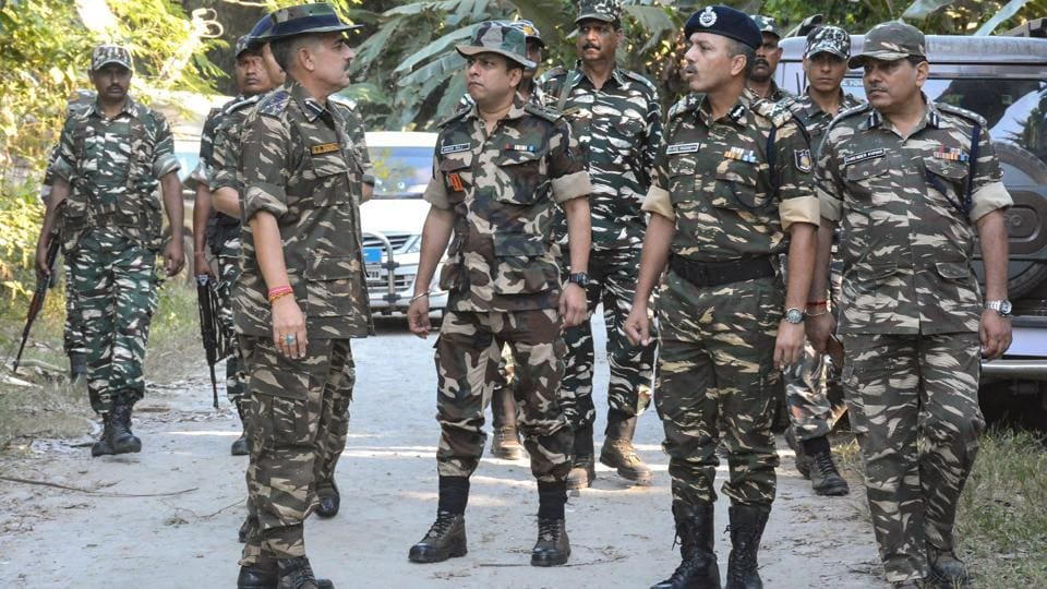 CRPF officials inspect the area after five people were killed by suspected United Liberation Front of Assam (ULFA) , at Tinsukia district of Assam, on November 2.