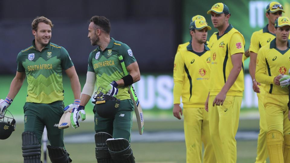 South Africa's David Miller (left) and Faf du Plessis, second left, leave the pitch after defeating Australia in their one-day international cricket match in Perth.