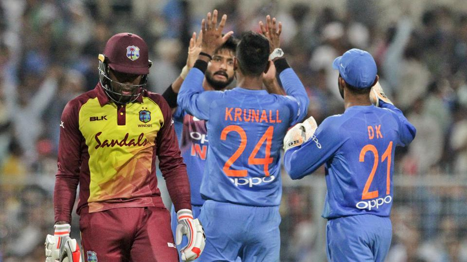 West Indies' Fabian Allen, left, leaves the field after being dismissed by India's Khaleel Ahmed, second left, during the first Twenty20 international cricket match between India and West Indies in Kolkata.