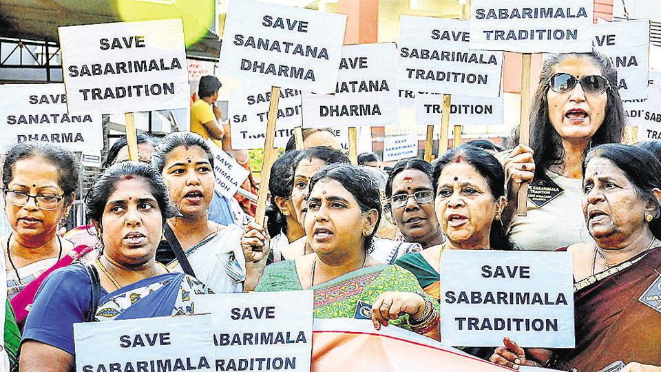 Lord Ayyappa devotees display placards during a protest rally against the Supreme Court order that allowed entry of women of all ages into the Sabrimala temple.