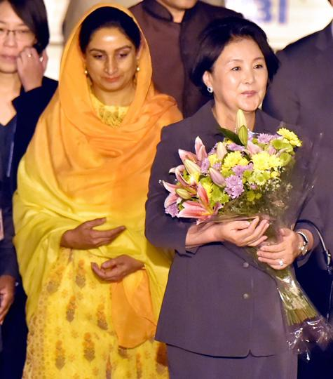 South Korean First Lady Kim Jung being received by Union minister Harsimrat Kaur Badal on her arrival at the AFS Palam in New Delhi on Sunday.