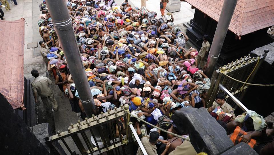 Devotees enter inside Lord Ayyappa Temple as the gates open in Sabarimala on October 17.