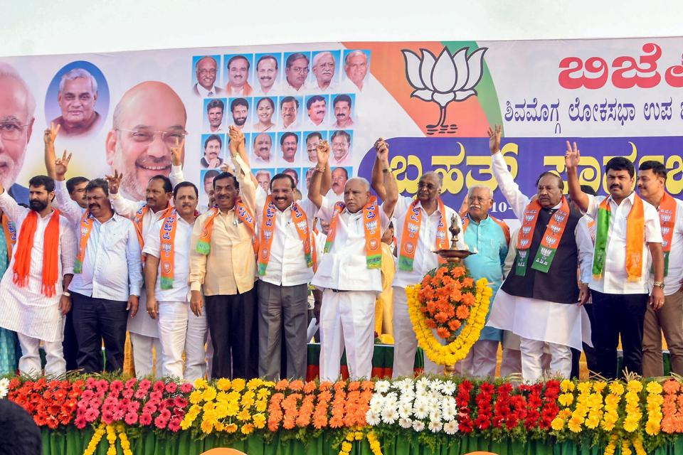 Former chief minister and Karnataka BJP President BS Yeddyurappa, senior state leaders KS Eshwarappa and Sadananda Gowda with party candidate for Shimoga Lok Sabha seat Raghvendra join hands to show unity during an election rally in Shivamogga on October 31.