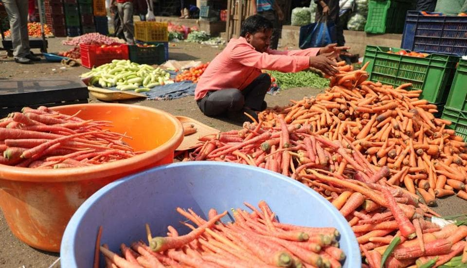 Vegetables hit low rates at market yard in Pune, on Sunday