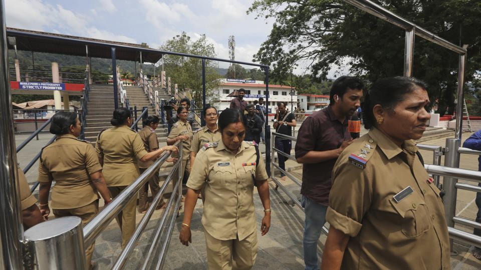 Devices to block phone calls and other radio signals, commandos and some 2,300 police personnel, including women officers above the age of 50 in a three tier system were put in place at the Lord Ayyappa shrine and its base camps, with the Sabarimala temple's doors scheduled to open at 5pm Monday for a special one-day puja. (Manish Swarup / AP)