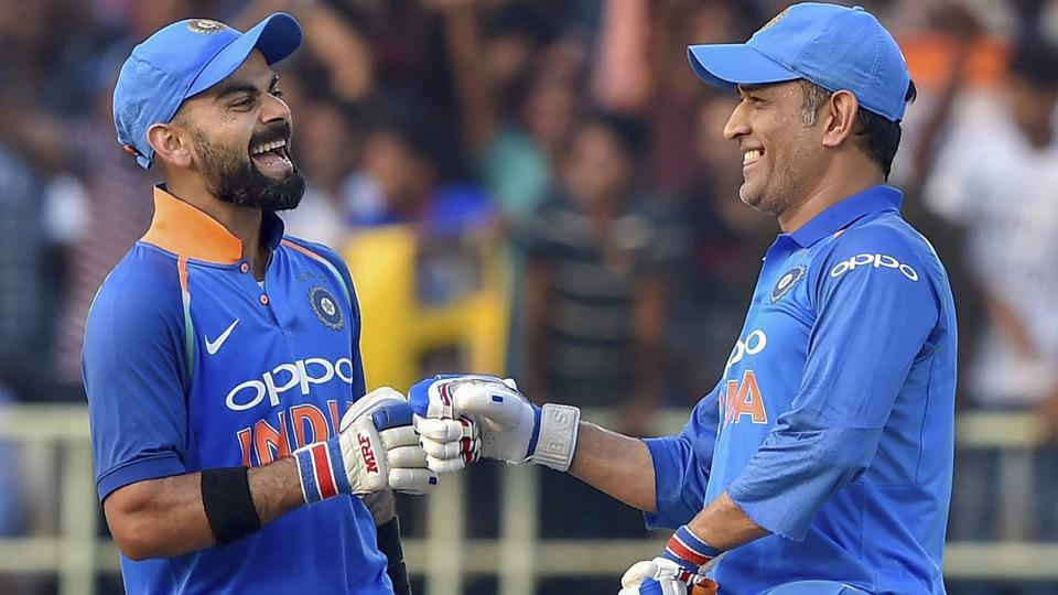 Virat Kohli and MS Dhoni celebrate after the former completed his complete 10,000 ODI runs during the 2nd ODI  against West Indies.
