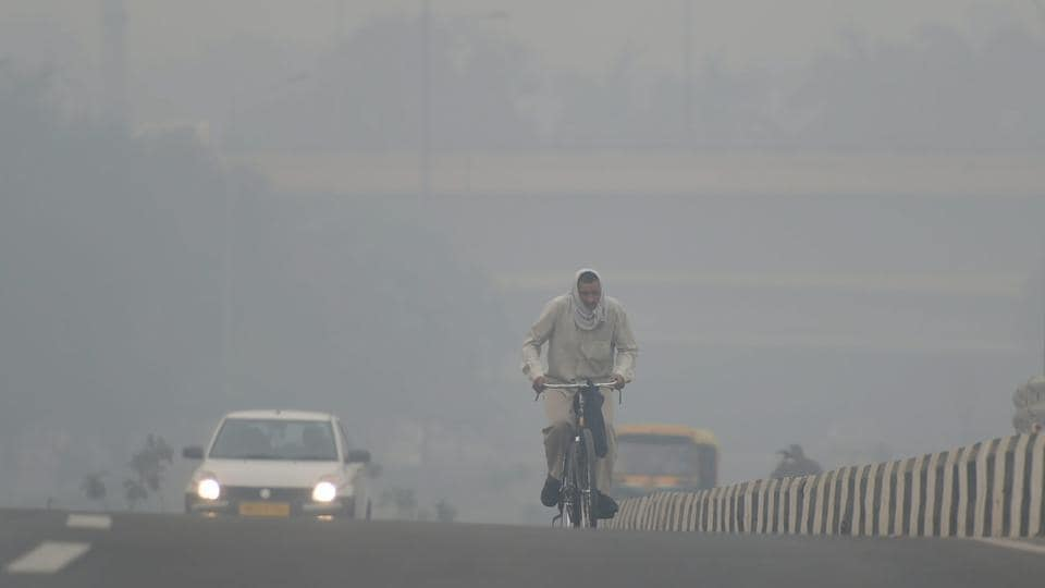 A cyclist rides through heavy haze, in New Delhi on Monday. According to the officials, pollution levels have sharply spiked today as a thick haze engulfed the national capital, ahead of Diwali, due to high impact of stubble burning that has pushed the air quality to the 'very poor' category.