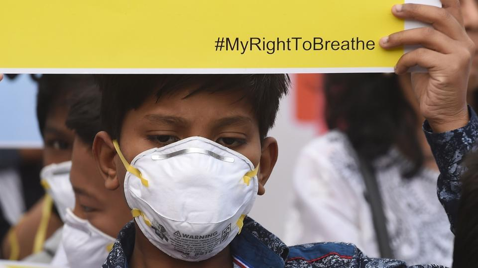 "A boy wearing a mask takes part in the ""My Right to Breathe"" awareness drive to highlight high levels of air pollution in New Delhi. On Tuesday, The national capital and its surroundings continued to suffer toxic air quality with only a slight improvement from Monday's ""severe"" category. (Prakash SINGH / AFP)"