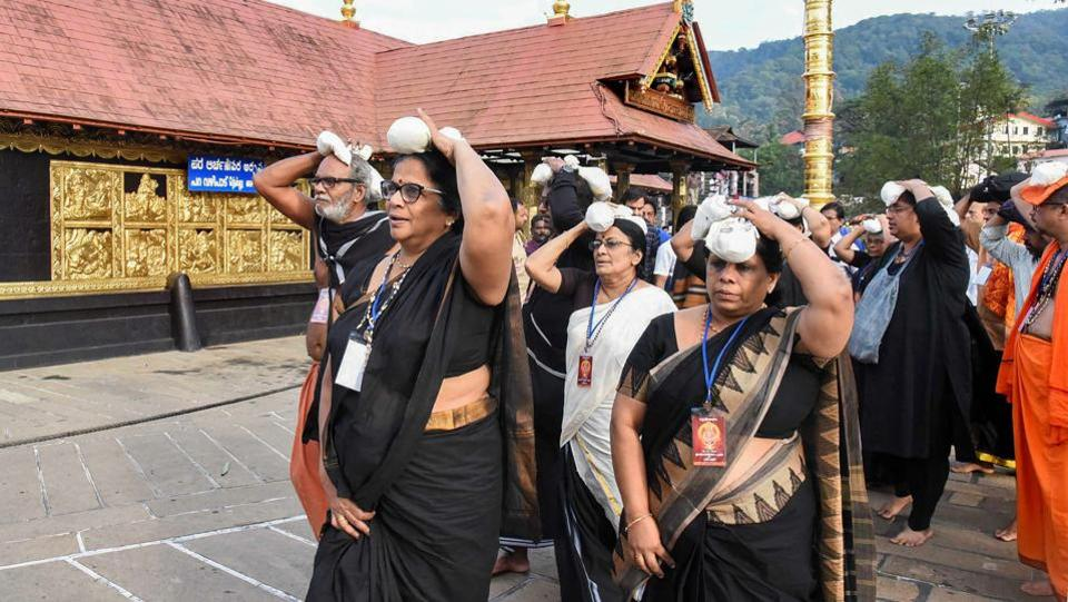 A group of elderly women arrive at Sabarimala temple, after a woman reached near the 18 holy steps of the hilltop shrine  at Sabarimala. After the temple reopened on Monday, protesters said 52-year-old Lalitha from Thrissur, who reached the 18 holy steps of the hilltop shrine, was lying about her age. She was forced to show her Aadhaar card to prove her age and police backed her claim. (PTI)