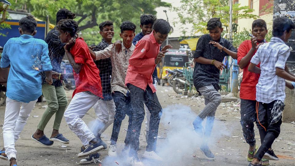 Youngsters burst firecrackers as they celebrate Diwali in Chennai.  People in Tamil Nadu began celebrating Diwali, starting off with special sesame oil bath, wearing new clothes and bursting firecrackers. (R Senthil Kumar / AP)