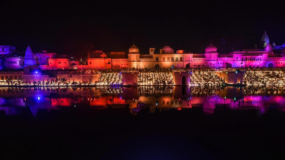 People light earthen lamps on the banks of River Saryu during Deepotsav in Ayodhya, Uttar Pradesh. (Nand Kumar / PTI)