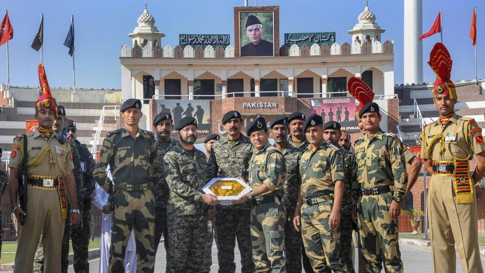 Pakistani border wing commander Usman Khalid (L) exchanges sweets with his Indian counterparts Border Security Force Commandant Sudeep on the occasion of the Diwali at the India-Pakistan Wagah border near Amritsar. (PTI)