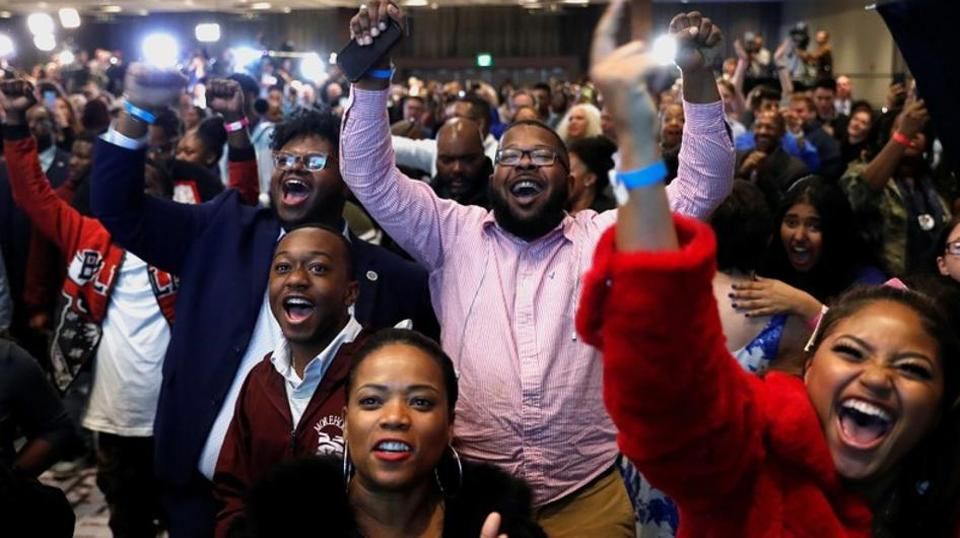 Supporters react after the Abrams campaign announced they were closing the gap during a midterm election night party for Georgia Democratic gubernatorial nominee Stacey Abrams in Atlanta, Georgia, US, November 6, 2018.