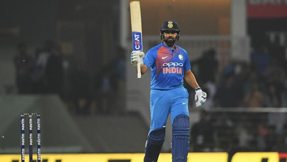 Indian cricket captain Rohit Sharma raises his bat after scoring a half century (50 runs) during the second T20 cricket match between India and West Indies at the Bharat Ratna Atal Bihari Vajpayee Ekana Cricket Stadium in Lucknow on November 6, 2018.