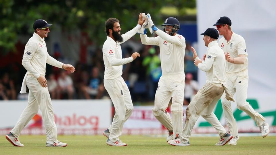 England's Moeen Ali (2nd L) celebrates with his teammates Ben Foakes (C), Jack Leach (2nd R), Keaton Jennings (R) and Jos Buttler after taking the wicket of Sri Lanka's Niroshan Dickwella (not pictured).
