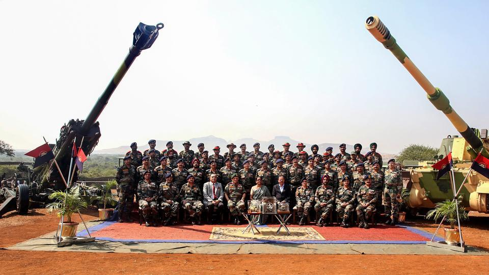 Defence Minister Nirmala Sitharaman, Army Chief General Bipin Rawat and others pose for a group photograph at the formal induction of three major artillery gun systems, including the M777 American Ultra Light Howitzers and the K-9 Vajra, into the Army during a ceremony at Deolali artillery centre, in Nashik district. (PTI)