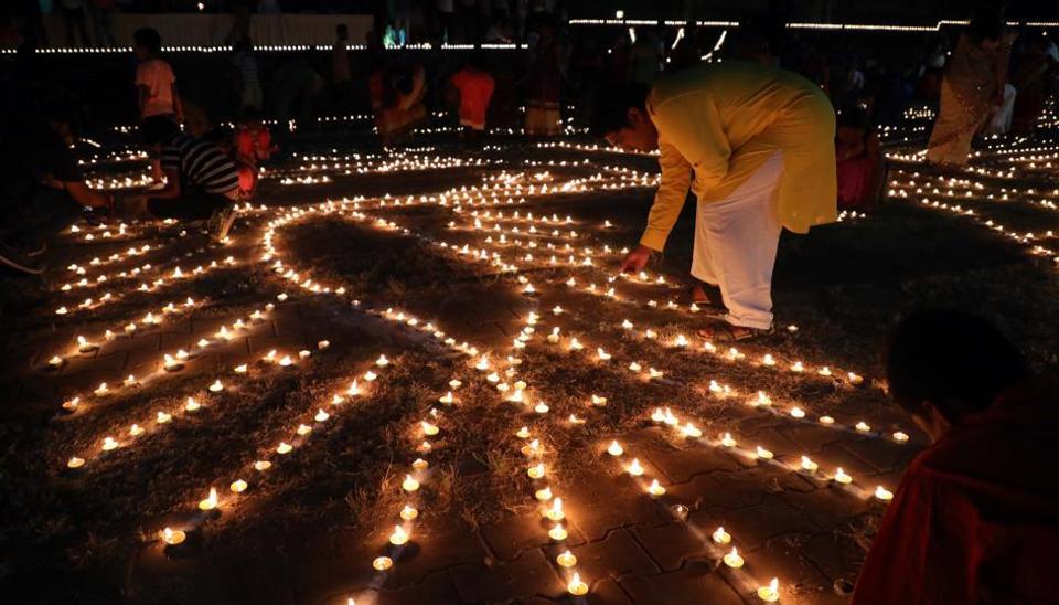 People celebrate Deepotsav at Shanivar Wada.  (Rahul Raut/HT PHOTO)