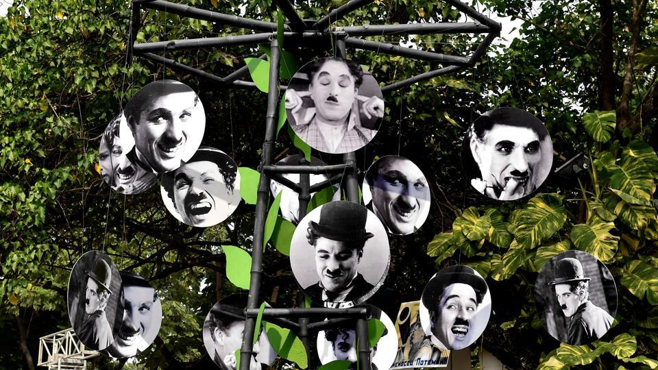 Pictures of the world's best-known comedian, Charlie Chaplin, hang from a temporary structure during preparations for the 'Kolkata International Film Festival 2018'. The week-long festival commences tomorrow. (Swapan Mahapatra / PTI)