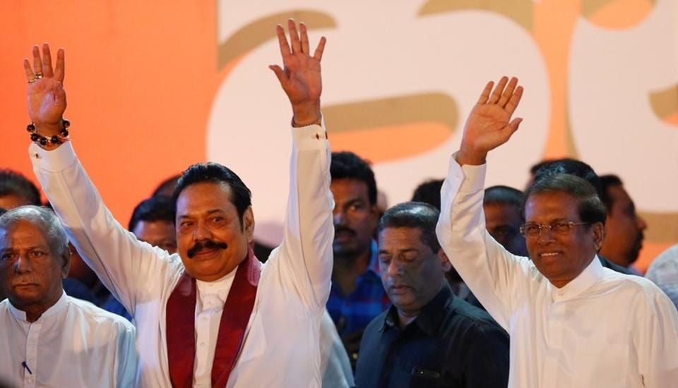 Sri Lanka's newly appointed Prime Minister Mahinda Rajapaksa and President Maithripala Sirisena wave at their supporters during a rally near the Parliament, Colombo, Sri Lanka, November 5, 2018