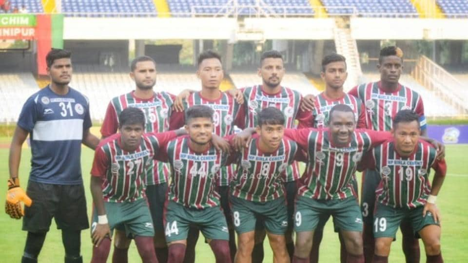 Players of Mohun Bagan football club pose for a picture ahead of a match.