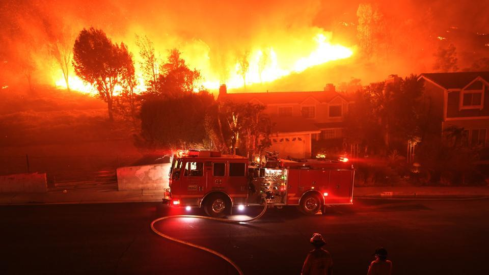 The remains of five of the victims were discovered in or near burned out cars, three outside residences and one inside a home, officials said. Another 35 people had been reported missing and three firefighters had been injured.