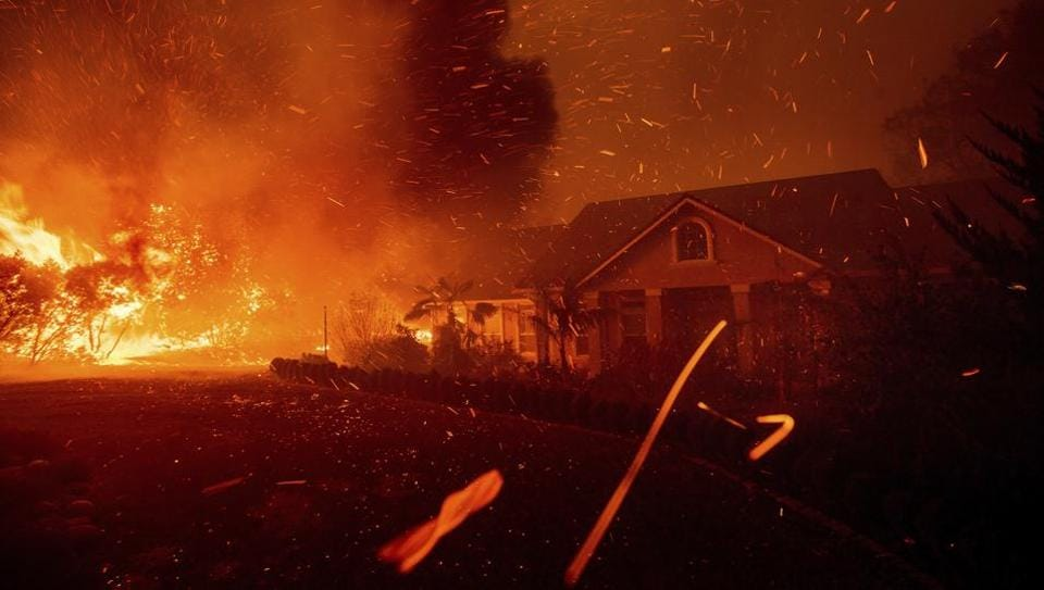 The Camp Fire rages through Paradise, California on Thursday. Not a single resident of Paradise — population 27,000 — could be seen anywhere in town Friday, the day after most of them fled the burning Northern California community that may be lost forever. Abandoned, charred vehicles cluttered the main thoroughfare, evidence of the panicked evacuation a day earlier. (Noah Berger / AP)