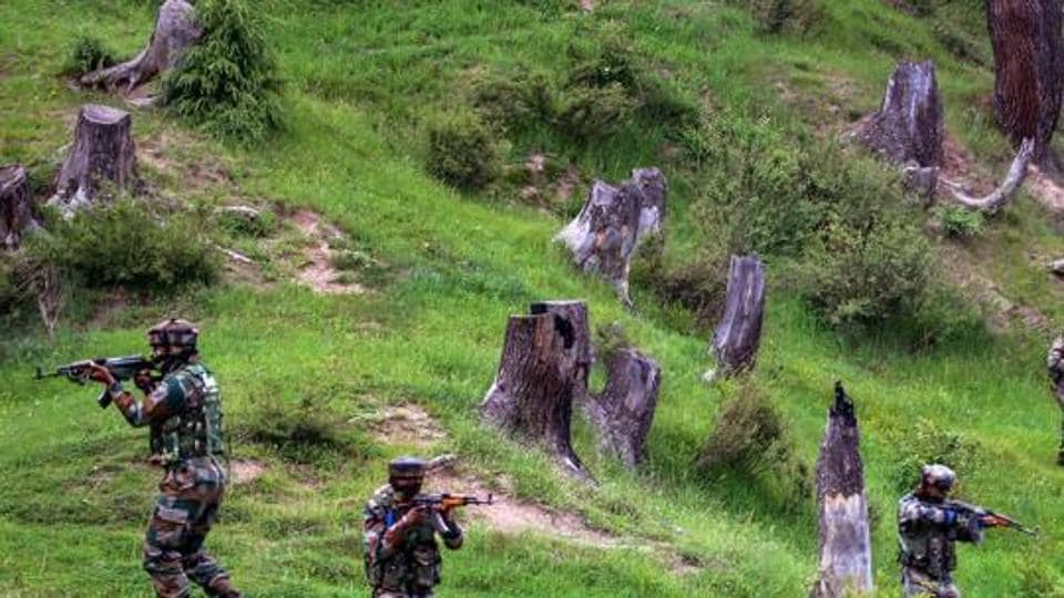 Security forces on Saturday gunned down two heavily armed terrorists hiding in a village in Jammu and Kashmir's Pulwama district, police said.