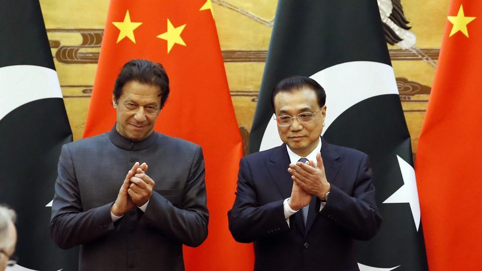 Pakistani Prime Minister Imran Khan and China's Premier Li Keqiang attend a signing ceremony at the Great Hall of the People in Beijing on November 3.