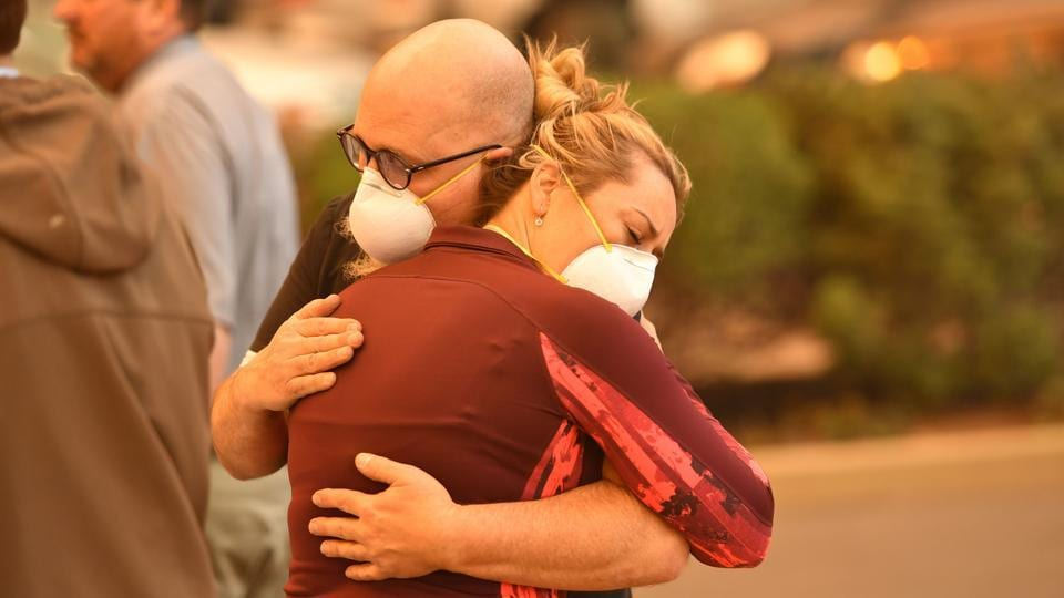 Two people embrace in the parking lot of the Feather River Hospital as it burns. Just 160km north of Paradise, the sixth most destructive wildfire in California history hit in July and August and was also one of the earliest. Called the Carr Fire, near Redding, it killed eight people, burned about 1,100 homes and consumed 927 square kilometers before it was contained. (Josh Edelson / AFP)